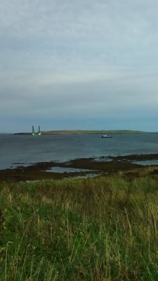 Jack-up vessel Juniper carries out sea-trials for installation of tidal turbines, with Stroma island behind. 25th September 2016.